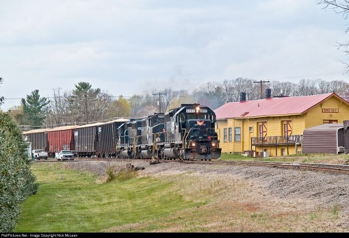 Yadkin Valley freight rolls past the restored Rural Hall station