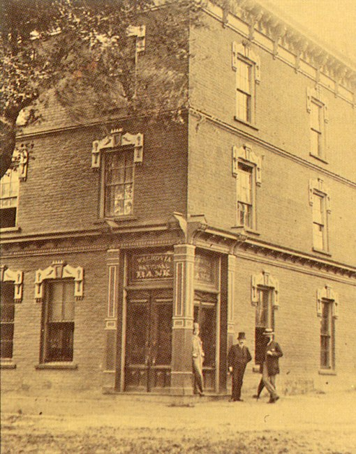 In 1888, Robert Gray's 1854 store on the corner of Main and Third Streets was extensively renovated to become the second home of Wachovia National Bank...left to right, teller George Brooks, James A, Gray, R.J. Reynolds...