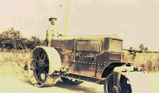 By 1930, mule power had given way to steam and gasoline...Captain Burke drives a steamroller...