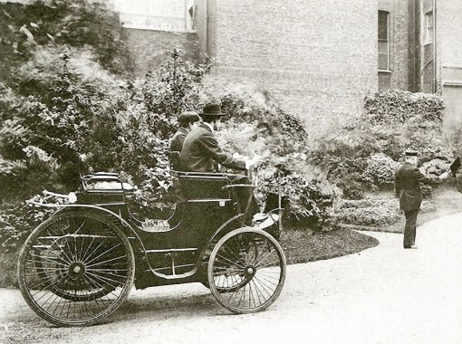 C.S. Rolls, later of Rolls-Royce fame, pilots a Peugot preceded by a man carrying a red flag, mid-1890s