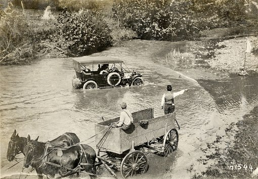 A Glidden Tour car fords a stream near Roanoke. Detroit Public Library.