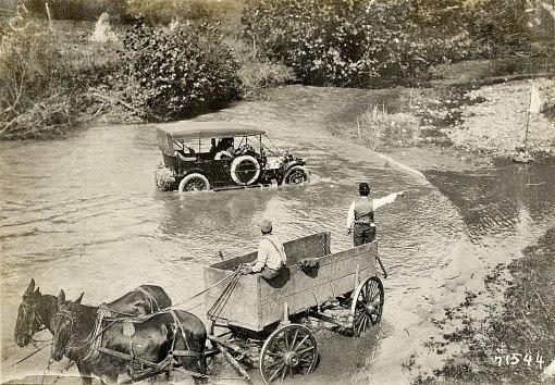 A Glidden Tour car fords a stream near Roanoke. Detroit Public Library.