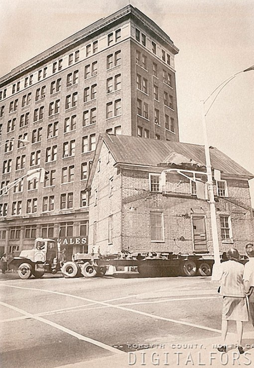 The Zevely House rolls past the O'Hanlon Building on its way to the West End, 1974