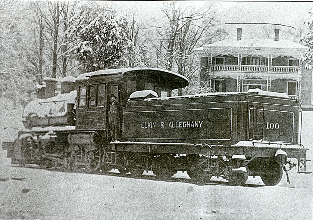 Elkin U0026 Alleghany Engine In The Snow Crossing Main Street In Front Of  Richard Gwynu0027s House, March 11, 1912. The Engineer Is Dallas McCoin.